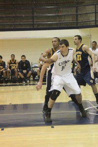 Sophomore center Brent Watkins fights for post position in a Feb. 6 game against the College of the Canyons.