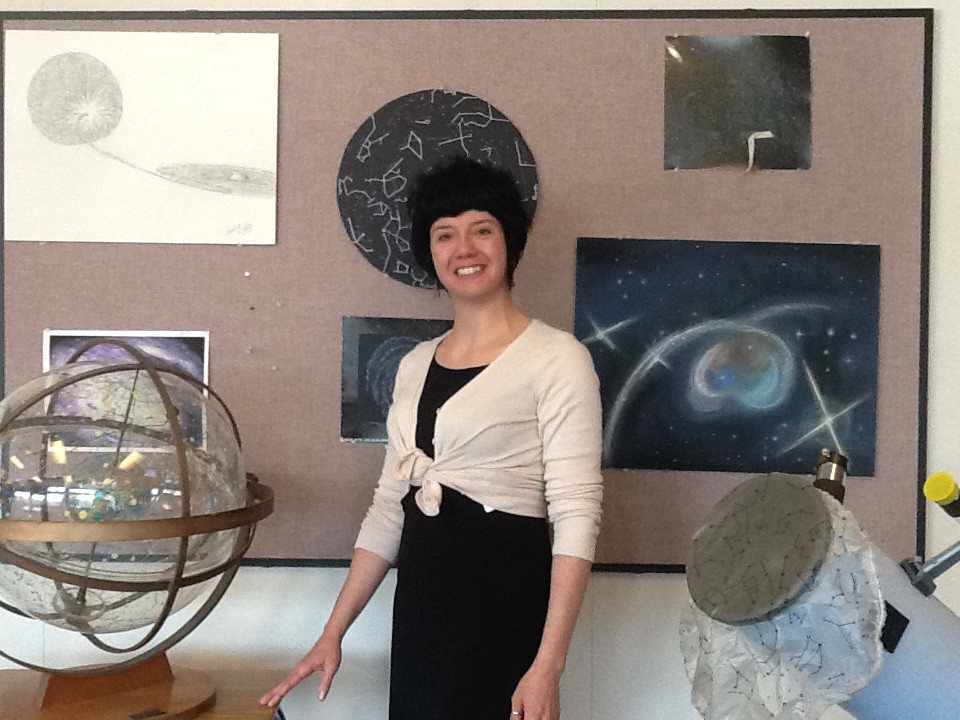 Denise Kaisler poses with some of the equipment in her ASTR 115 (Planetary Astronomy) class. Kaisler also teaches ASTR 116 (Stellar Astronomy) and 117 (Life in the Universe).