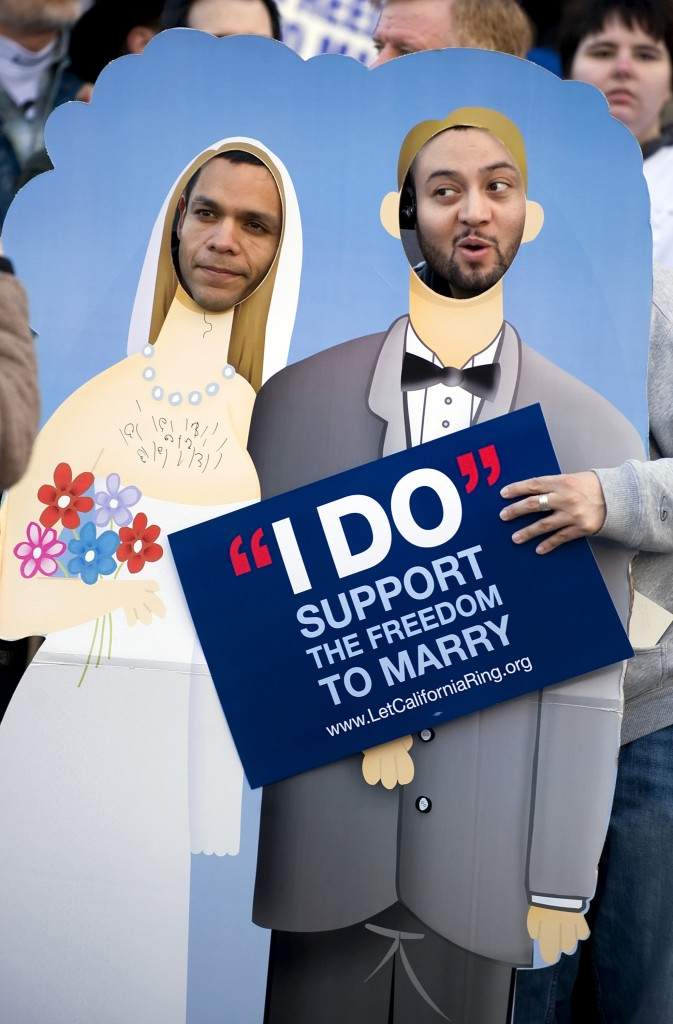 Luis Guerra and Walter Recinos, who were not married, stood in a cutout of a married couple as opponents to Proposition 8 gathered March 4, 2009, for a protest before the Supreme Court was set to hear arguments to overturn Prop. 8.
