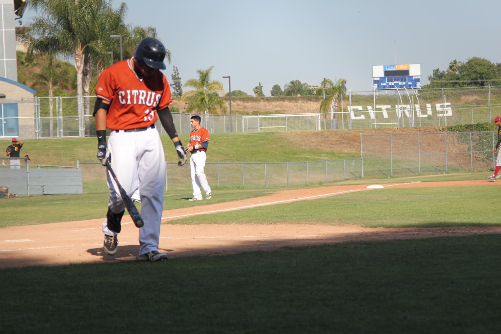 Jayson De La Pena walks to his bench after striking out to end the bottom of the 8th inning against the Glendale Vaqueros on April 26. Citrus would lose the game 7-3.