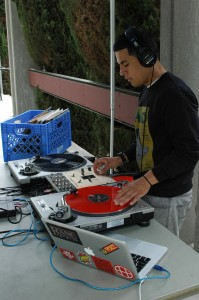 21-year-old Ghandy Soria, a.k.a. DJ Ghandy, spins the ones and twos during Springfest 2013 in the campus mall. (Cole Petersen / Citrus College Clarion)