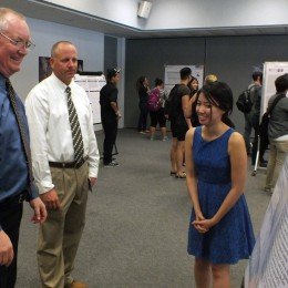 Susan Vong, 21, discussing her summer research on gravitational waves with faculty members, which was performed at CSUF.