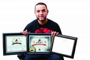 Julian Espejo pictured above with his awards he received while serving in the U.S. Army. (Jessica Soto/Citrus College Clarion)