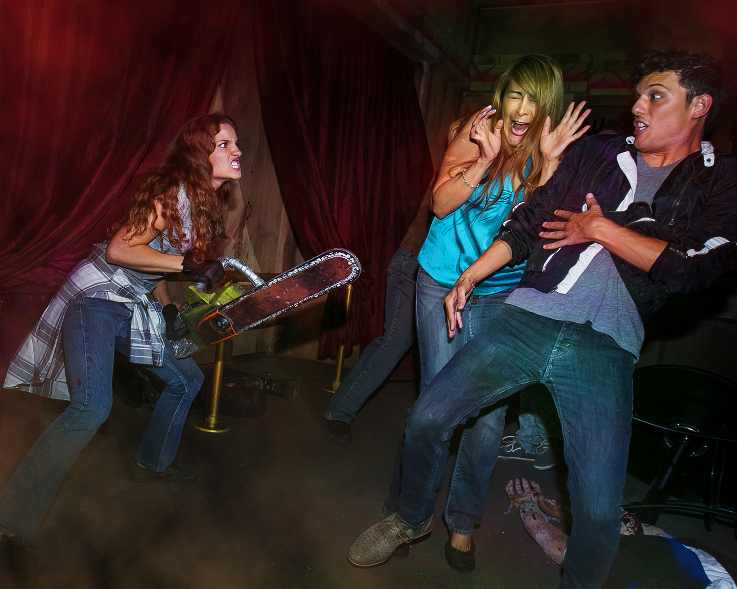 "Frightened visitors are sent shrieking away from  chainsaw swinging zombies throughout the ""From Dusk til Dawn maze."" Halloween Horror Nights will continue every Thursday through Sunday until Nov. 2 at Universal Studios. (Photo courtesy of Universal Studios)"