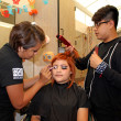 Cosmetology students Octavio Rosales, 20, and Lauren Chavira, 20, apply makeup and style hair on Stephanie Urbina, 22, in preparation for the Cosmetology Club's annual Halloween hair show. The competition is Oct. 30 in the Campus Center at 6 p.m.
