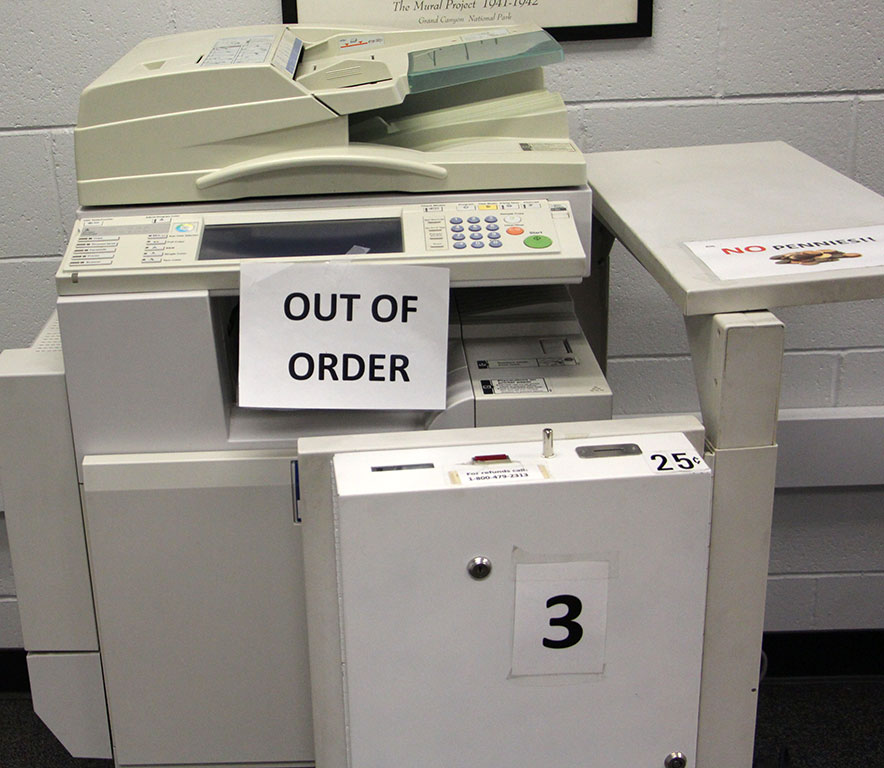 A jammed black and white printer in the Hayden Memorial Library on Oct. 20. (Megan Bender/Clarion)