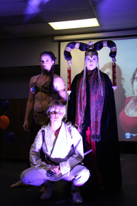 """The """"Star Wars"""" trio made up of Shella Walker as prisoner Princess Lea(left),  Kristen Clausen as Luke Skywalker(center)  and Rachael Near as Queen Amidala of Naboo(right). The trio styled each others hair and make up for the Halloween Hair Show."""