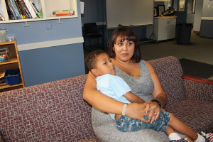 Astrid Perez Clarion Elizabeth Saucedo pictured with her son Gabriel play in the Veterans Center.
