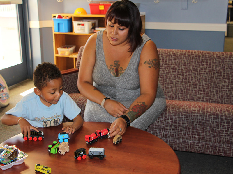 Astrid Perez Clarion Elizabeth Saucedo, keynote speaker at the 10th Annual Saluting Our Veterans, and her son Gabriel play in the Veterans Center. Saucedo proudly served in the U.S. Army from 2007-2010.