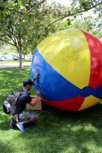 "Communications major Matthew Luna wrote on the large free speech beach ball in the Campus center Mal on April 25, responding to a message claiming ""Socialism is low key Communism."" He added ""when its right winged, the Fire Department is a socialist program. Question all aspects of Democracy and form your own opinion."""