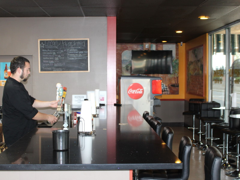 Daniel Hope serves one of 11 beer options on tap at Kraphy's Italian Eatery. Kraphty's which official opened _____, owned and run by Hope who has a deep love of cooking and creating his own recipes.