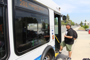 Studio arts major Ernest Santos steps onto the 281 Foothill Transit bus to go home to San Dimas after school. The 281 is one of several bus lines that service Citrus College that more students will have access to once the Class Pass program is implemented this fall. (Darius Johari/Clarion)