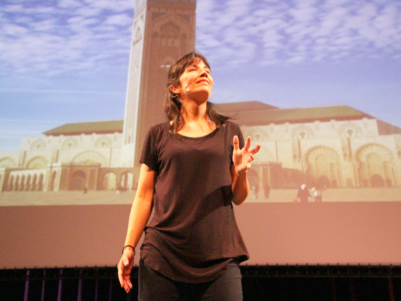 """Elizabeth Liang performs her monologue """"Alien Citizen, an Earth Odyssey"""" on May 5 at the Haugh Performing Arts Center. Liang grew up as a """"third culture kid,"""" who lived in six different countries by the time she was in college."""