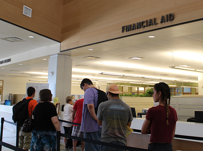 Citrus College students wait in line on Aug. 22 at the Financial Aid desk inside the Student Services building. Starting this semester, students are required to maintain at least a 2.0 grade point average for two consecutive semesters in order to be eligible for the B.O.G. fee waiver.