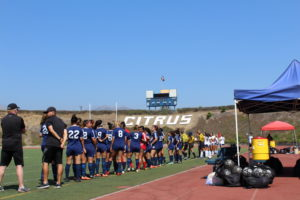 The Owls line up to begin their first game at Citrus Stadium, playing San Diego Mesa College.