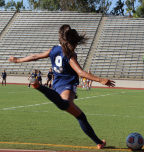 Freshman defender Yasmine Ramirez delivers a corner kick to assist fellow defender Sydney Lujan on a goal for Citrus' fourth goal of the match against West LA, Sept. 16, 2016.