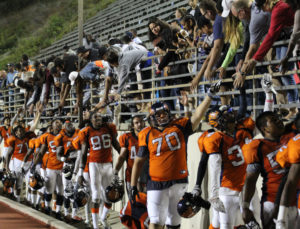The Citrus Owls celebrate with fans after winning 48-41 in over time. The Owls opened Sept. 3 at home Citrus Stadium. Click for full-size.