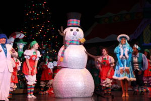 The Citrus singers perform with a life-sized Frosty the Snowman on Nov. 28 at the Haugh Performing Arts Center. The snowman was created using disco balls from a previous production. Photo by John Michaelides.